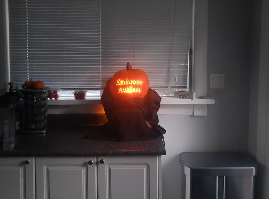 A photograph of the 'Embrace Autism' pumpkin in our kitchen.