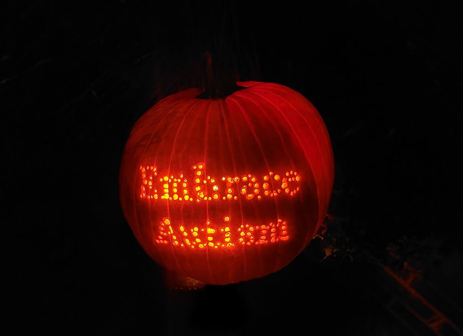 A photograph of the 'Embrace Autism' pumpkin up close.
