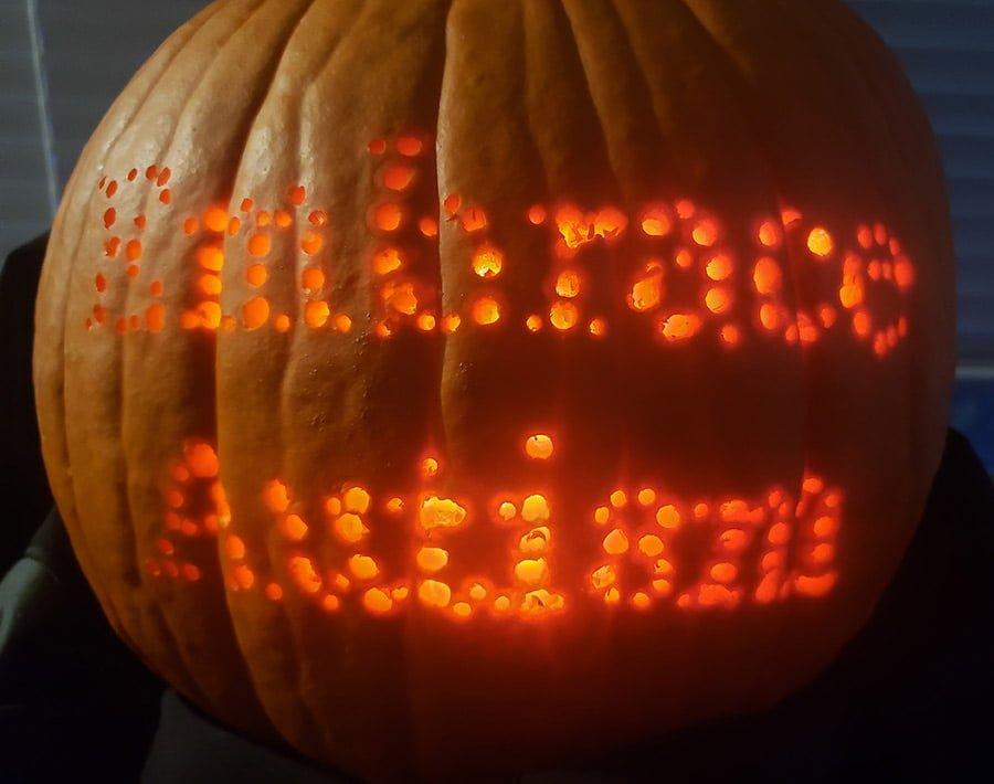 A photograph of the 'Embrace Autism' pumpkin up close.