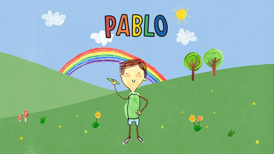 A picture of Pablo in his imaginary world, standing in front of a rainbow and about to draw something fantastic.
