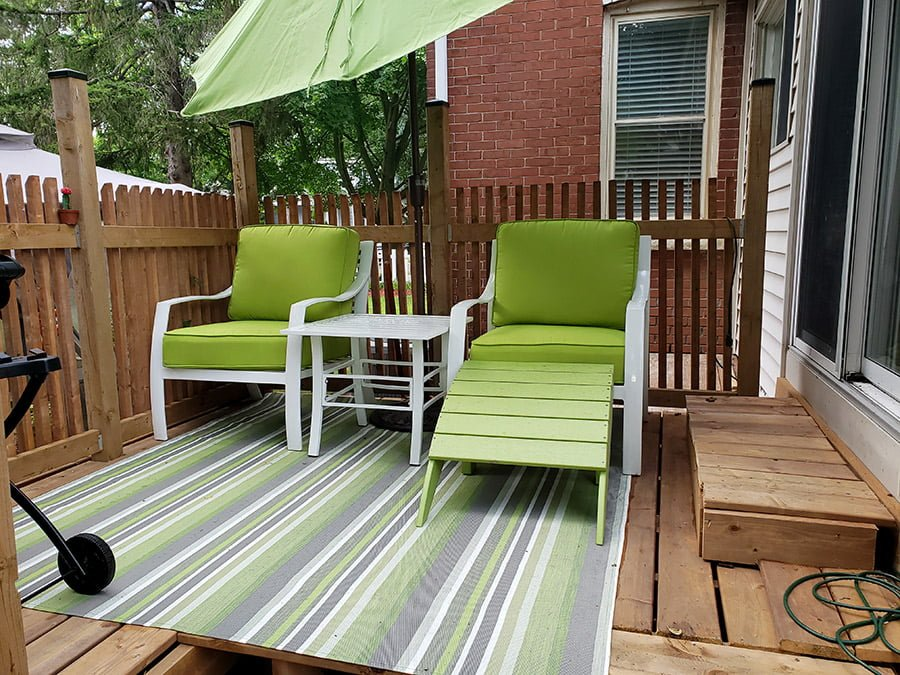 A photo of our new deck and comfortable garden chairs.