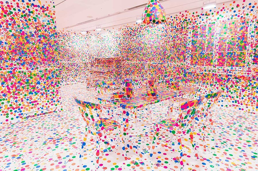 A photo of an artwork called 'Obliteration Room', by Yayoi Kusama.